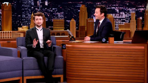 """Actor Daniel Radcliffe talks with Jimmy Fallon on September 12, 2018, on """"The Tonight Show"""" set."""