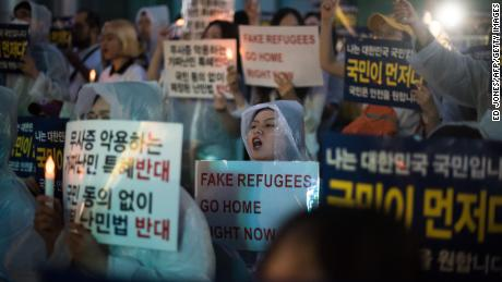 Anti-immigration activists attend a protest against a group of Yemen asylum seekers, Seoul, June 30, 2018.