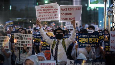 Anti-immigration activists attend a protest against a group of asylum-seekers from Yemen, in Seoul on June 30, 2018.