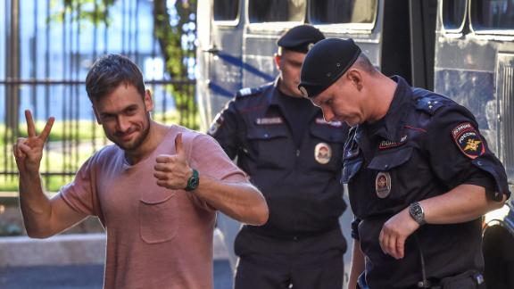 Reports say Pussy Riot member Pyotr Verzilov, seen here attending an appeal hearing at a court in Moscow in July, has been urgently hospitalized in the toxicology intensive care unit of a Moscow hospital for suspected poisoning.