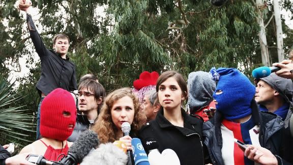 A member of a pro-Kremlin youth organization throws a chicken during a Pussy Riot press conference in Sochi in 2014.