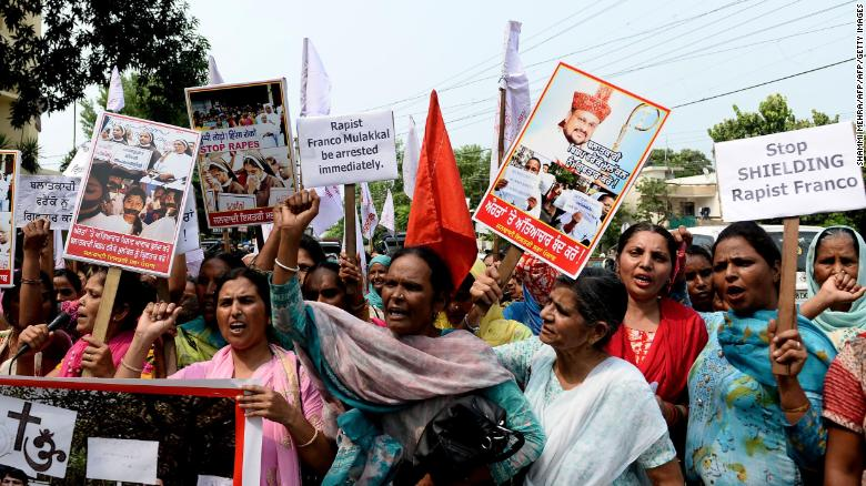 Indian women hold placards and chant slogans during a September 2018 protest march to demand the immediate arrest of Roman Catholic church Bishop Franco Mulakkal, who is accused of raping a nun.