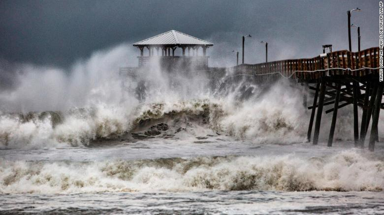 Waves crash around Oceanana Pier in Atlantic Beach, North Carolina, as the outer bands of Hurricane Florence begin to affect the coast on Thursday, September 13.