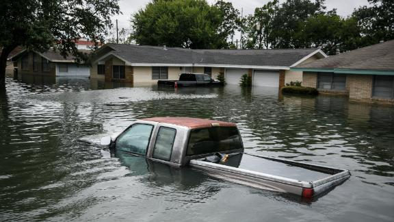 PORT ARTHUR, TX : Floodwater engulf homes in the wake of Tropical Storm Harvey in Port Arthur, Texas. Storms in 2017 made it the third most expensive year on record for the National Flood Insurance Program, prompting Congress to forgive $16 billion in taxpayer money it owed to the federal government.