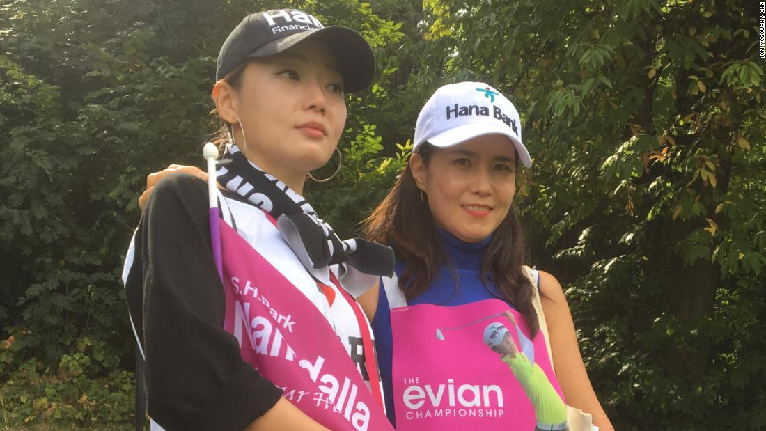 Amin Moh (left) and Eun Sun Kim have traveled from Seoul, Korea to Evian-les-Bains in France to follow their hero, Sung Hyun Park.