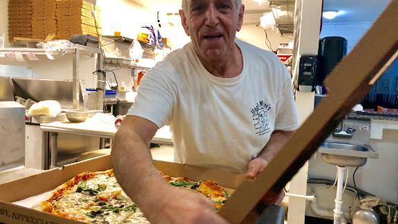 Mikey Zalloum makes pizza Thursday night at his Myrtle Beach, South Carolina, restaurant.