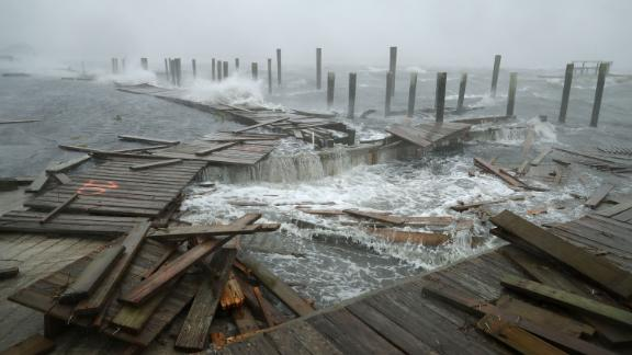 Powerful winds and waves destroy portions of a boat dock and boardwalk in Atlantic Beach on September 13.