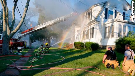 Firefighters battle a house fire Thursday in North Andover, Massachusetts.