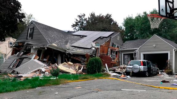A residence in Lawrence is reduced to mostly rubble Thursday.