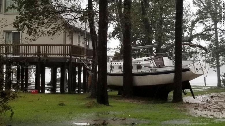 A boat is wedged in trees Friday in Oriental, North Carolina, in a photo from Angie Propst.