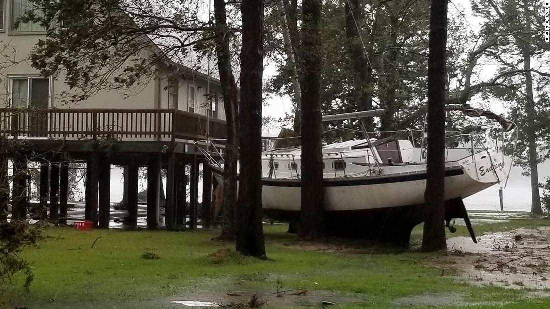 A boat sits wedged in trees in Oriental, North Carolina, near New Bern, on September 14.
