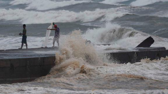 Fishermen work amid the rough seas near Aparri on September 14.