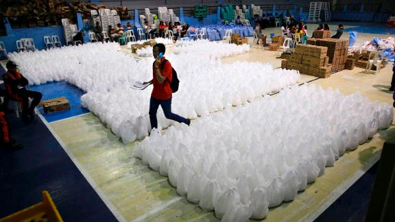 A volunteer moves through relief goods September 14 as Tuguegarao prepares for the typhoon