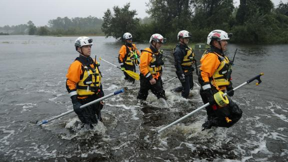 Members of a Federal Emergency Management Agency team from California search a flooded neighborhood in Fairfield Harbour, North Carolina, on September 14.