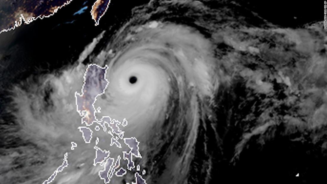 A satellite image with land graphic borders shows the width and trajectory of Typhoon Mangkhut as it approaches the Philippines, on Friday, September 14.