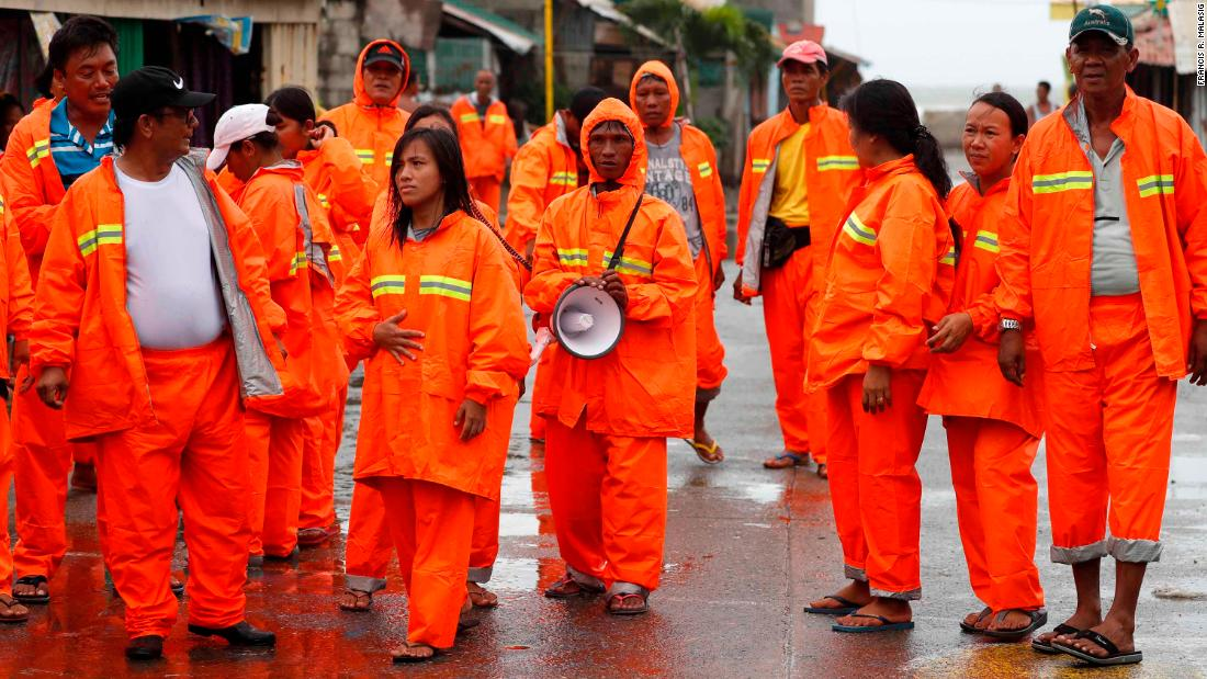 Filipino village officials conduct patrol in the town of Aparri, ahead of Typhoon Mangkhut landfall in the region, in Cagayan province, Philippines, 14 September 2018. Philippines braced for the arrival of Typhoon Mangkhut, ranked as the most powerful storm of the year to enter the Philippines, as it was expected to hit the northern island of Luzon.  EPA-EFE/FRANCIS R. MALASIG Francis R. Malasig