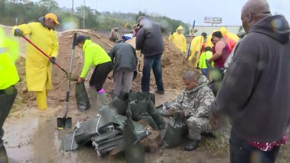 Over 100 people answered a Facebook call Friday, September 14, 2018, to help fill sandbags and barricade off much of Lumberton, North Carolina, to prevent flooding from the Lumber River.