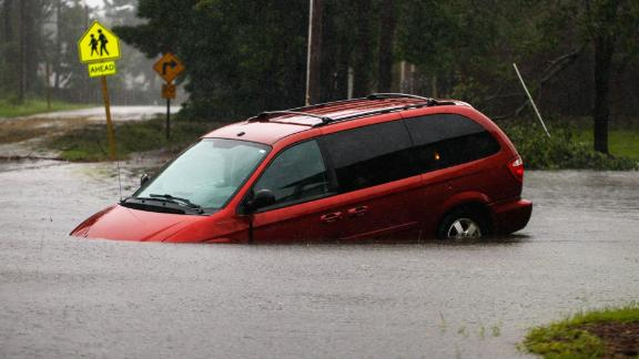 An abandoned van sits on a flooded road near New Bern on September 14.