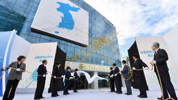 South and North Korean officials attend an opening ceremony of a joint liaison office in Kaesong, North Korea, on September 14, 2018. - North and South Korea opened a joint liaison office in the Northern city of Kaesong on September 14, as they knit closer ties ahead of President Moon Jae-in's visit to Pyongyang next week. (Photo by - / KOREA POOL / AFP) / South Korea OUT        (Photo credit should read -/AFP/Getty Images)