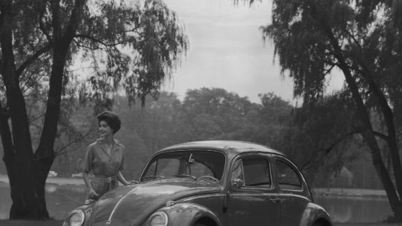 The Beetle gained cult-like status in the 1960s. Here, a model poses for a promotional image with a 1962 sedan.