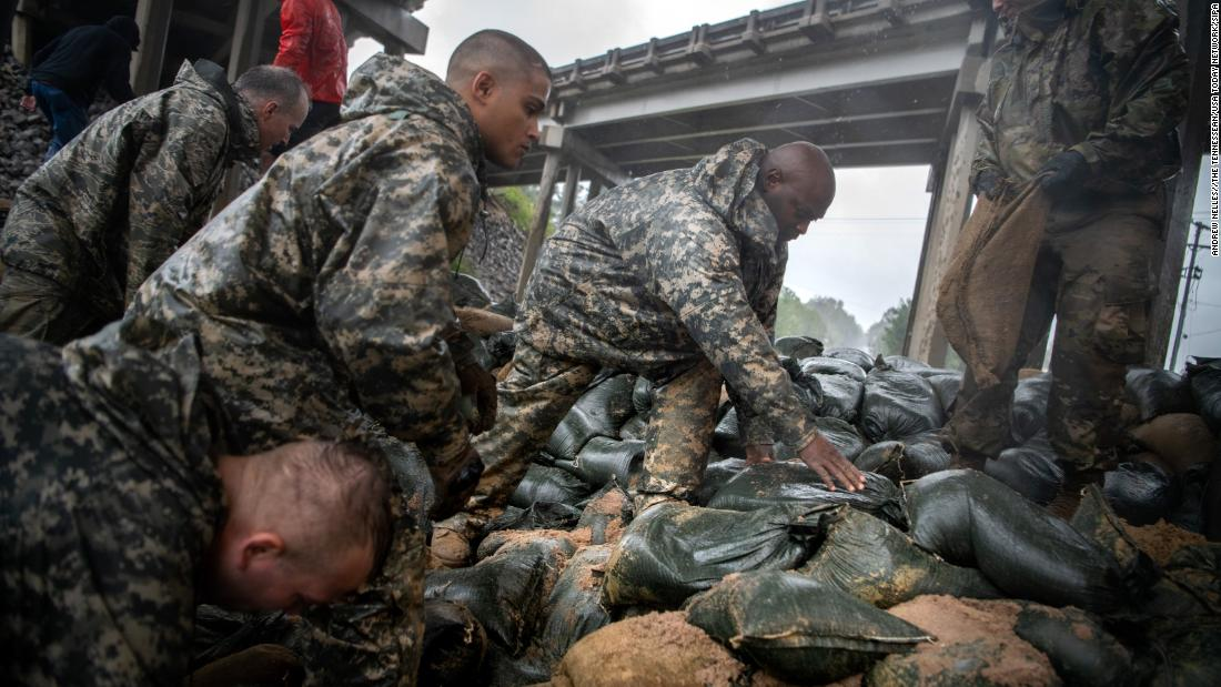 Soldiers from the North Carolina National Guard reinforce a low-lying area with sandbags in Lumberton, North Carolina, on September 14.