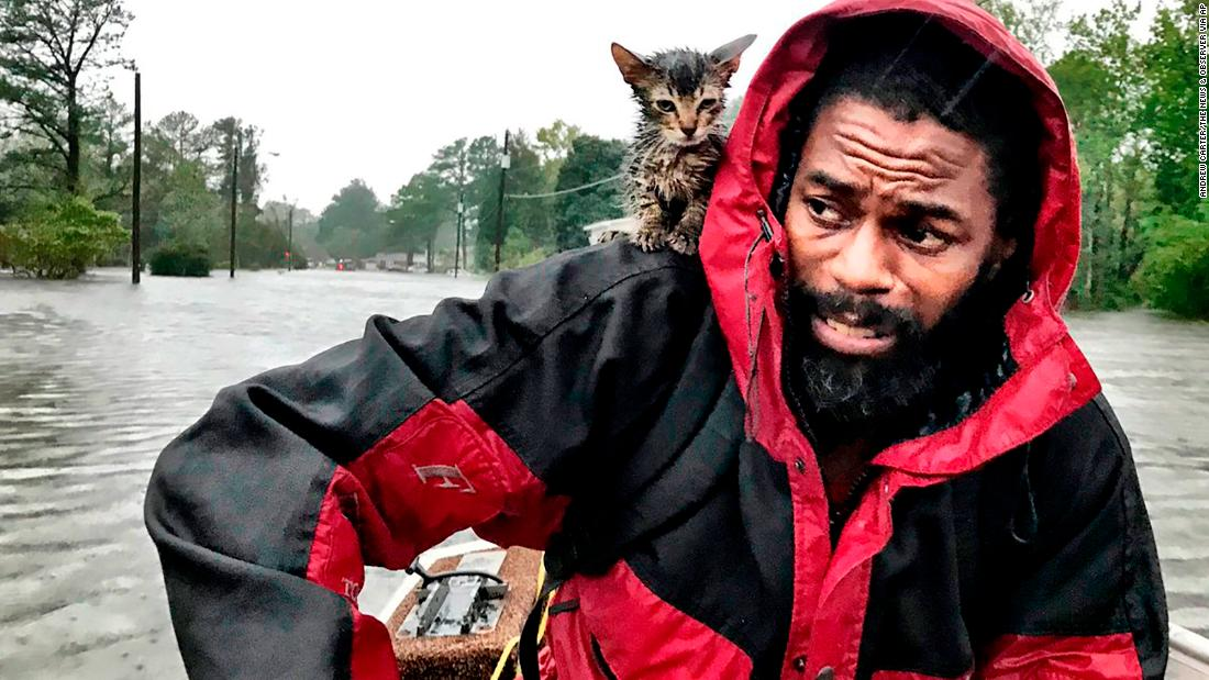 Robert Simmons Jr. and his kitten are rescued from floodwaters in New Bern on September 14.