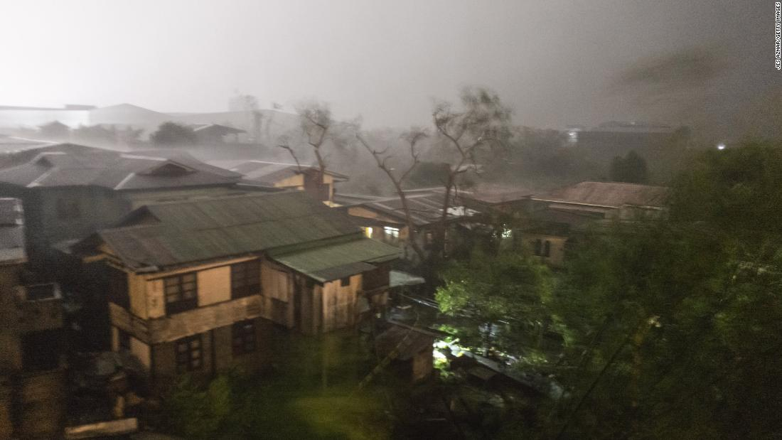 Rains cover Tuguegarao City, Philippines, as strong winds batter houses and buildings in the path of Typhoon Mangkhut as it makes landfall on Saturday, September 15.