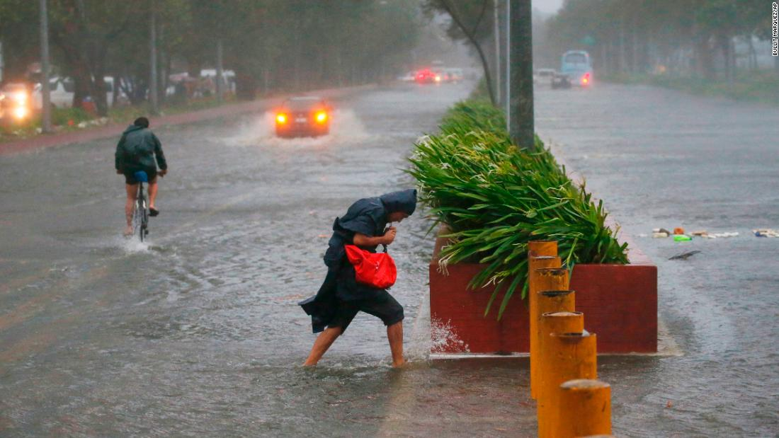 Commuters brave the elements in Manila on September 15.