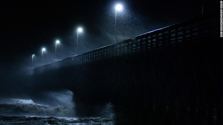 Waves crash into the Second Avenue Pier in Myrtle Beach, South Carolina, on Friday, September 14.