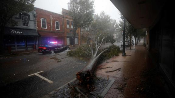 The storm leaves a tree toppled in New Bern on September 14.