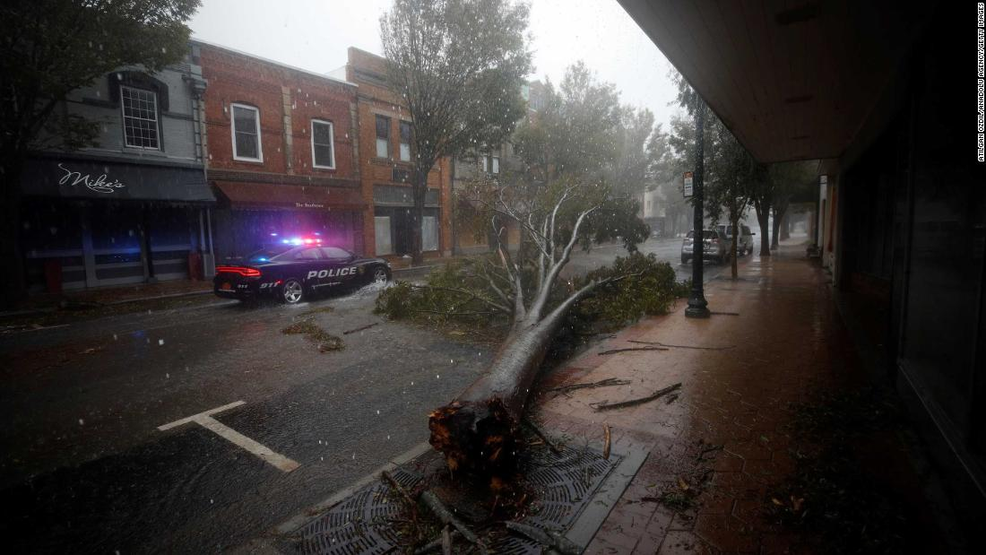 The storm leaves a tree toppled over in New Bern on September 14.