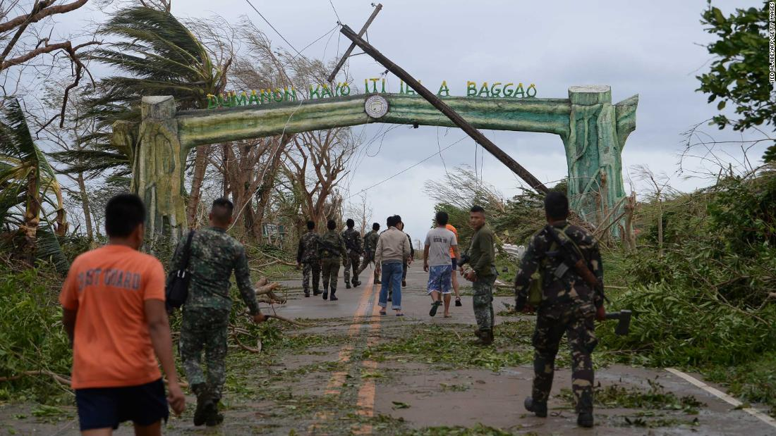 Crews work to clear a road of debris in Baggao on September 15.