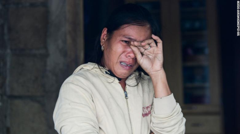 A woman weeps as she describes her family's experiences during the typhoon in Baggao on September 15.
