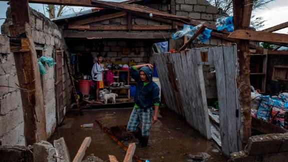 Members of a family survey their heavily damaged home in Alcala, Philippines, on September 15.