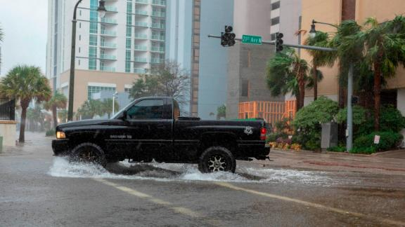 A car drives though rising floodwaters near the beach as Hurricane Florence makes landfall on Friday in Myrtle Beach, South Carolina.