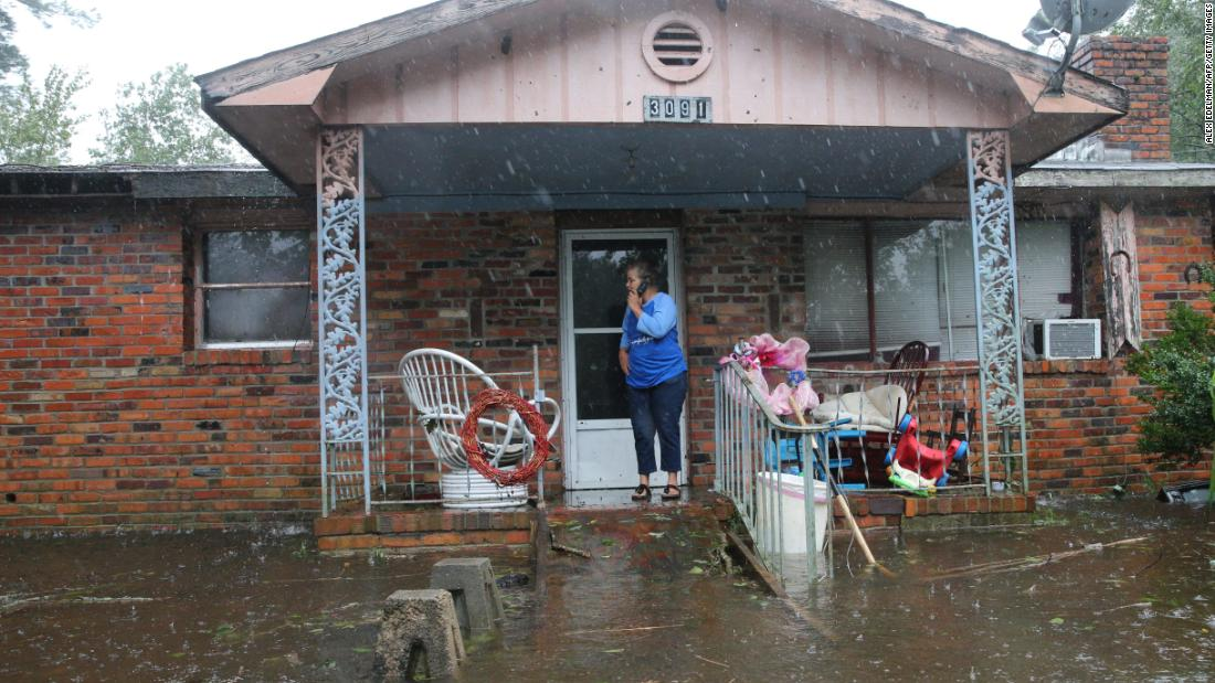 A woman calls for help at her flooded residence as Florence brought large amounts of rain and floodwaters to Lumberton, North Carolina, on Saturday.