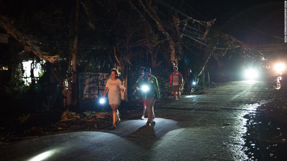 Volunteers and police check on residents after Typhoon Mangkhut hit Tuguegarao, Philippines, on Saturday.