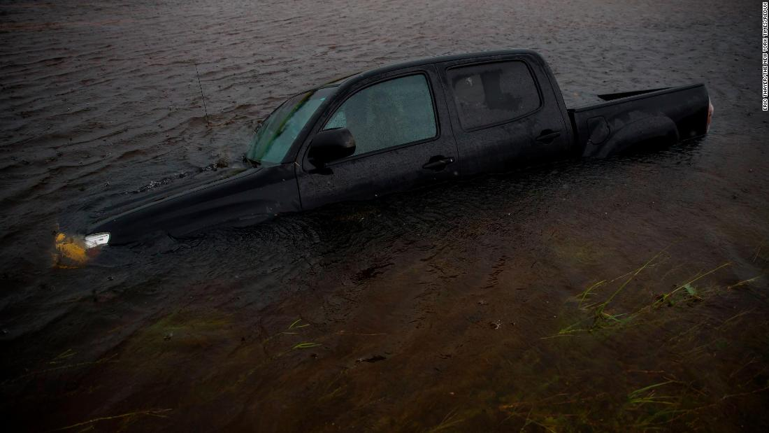 A truck is submerged in floodwaters in Jacksonville, North Carolina on Saturday, September 15.