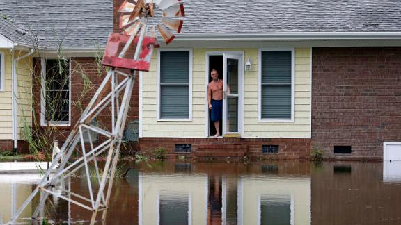 A man peers from his flooded home in Lumberton on September 16.