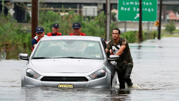 Members of the Coast Guard help a stranded motorist in floodwaters in Lumberton, North Carolina, on September 16.