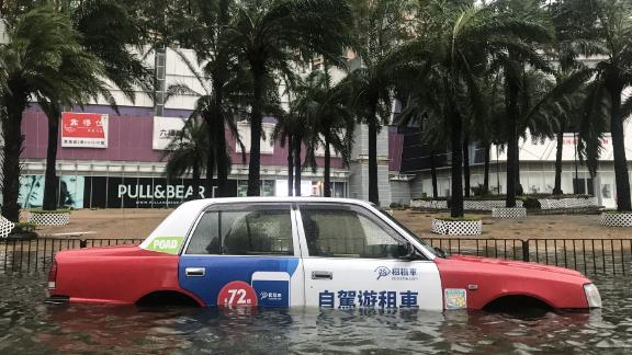 A taxi is left abandoned after breaking down in Hong Kong.