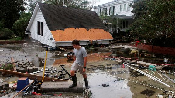 Joseph Eudi surveys flood debris and storm damage from Hurricane Florence at a home in New Bern, North Carolina, on Saturday.