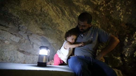 Jomana's PKG on the story of Huthaifa al-Shahad, a father in Idlib doing all he can to protect his family from the looming offensive in Idlib. He dug an underground shelter under his home and he's building makeshift gas masks for his children. Requires voice-over dubbing of arabic SOTs.