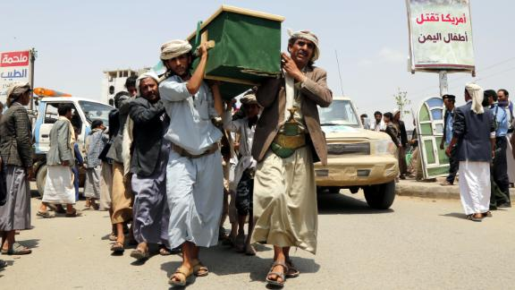 Mourners carry the coffin of a child at the funeral procession for those killed in an airstrike on August 13, 2018 in Saada, Yemen. Fifty-one people, including 40 children, were killed in the attack and at least 79 others were wounded, of which 56 were children, according to published reports.