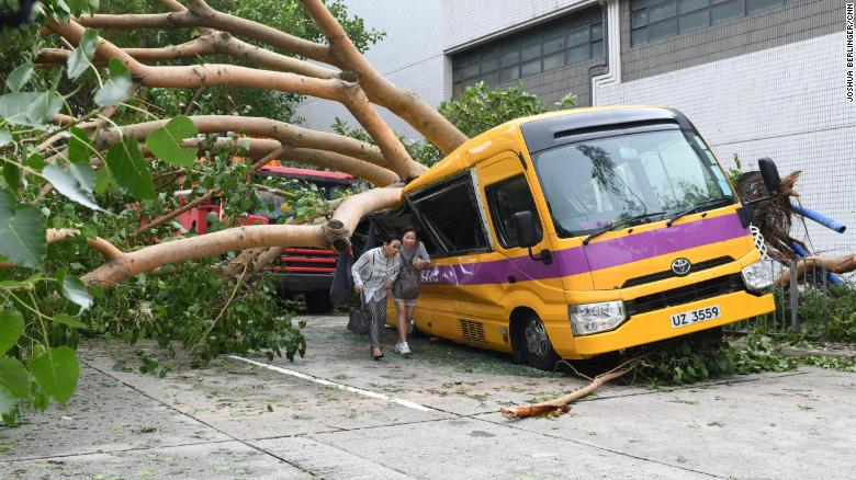A school bus in Hong Kong's Heng Fa Chuen is seen after being destroyed by a tree during Typhoon Mangkhut.
