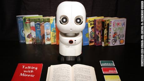 Minnie, a learning companion robot, listens and makes occasional comments while children read.