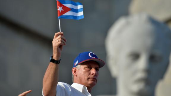 Cuban President Miguel Diaz-Canel waves a national flag during the May Day rally at Revolution Square in Havana on May 1, 2018. (Photo by Yamil LAGE / AFP)        (Photo credit should read YAMIL LAGE/AFP/Getty Images)