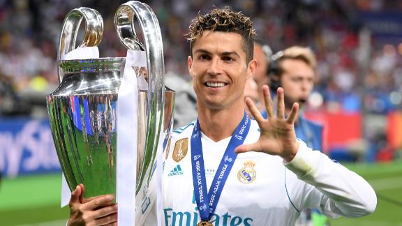 Cristiano Ronaldo celebrates his fifth Champions League trophy after beating Liverpool last season.