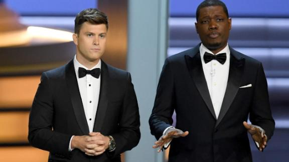Colin Jost  and Michael Che speak onstage during the 70th Emmy Awards