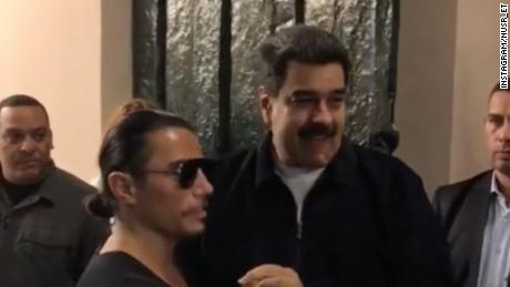 "Venezuelan President Nicolas Maduro spotted with Turkish celebrity chef Nusret Gökçe, known as ""Salt Bae,"" at one of his Istanbul restaurants."
